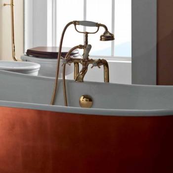 Banheira autônoma com cobertura exterior em ferro fundido